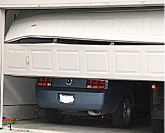 Garage door panel repair in dallas nation overhead for Garage door repair plano